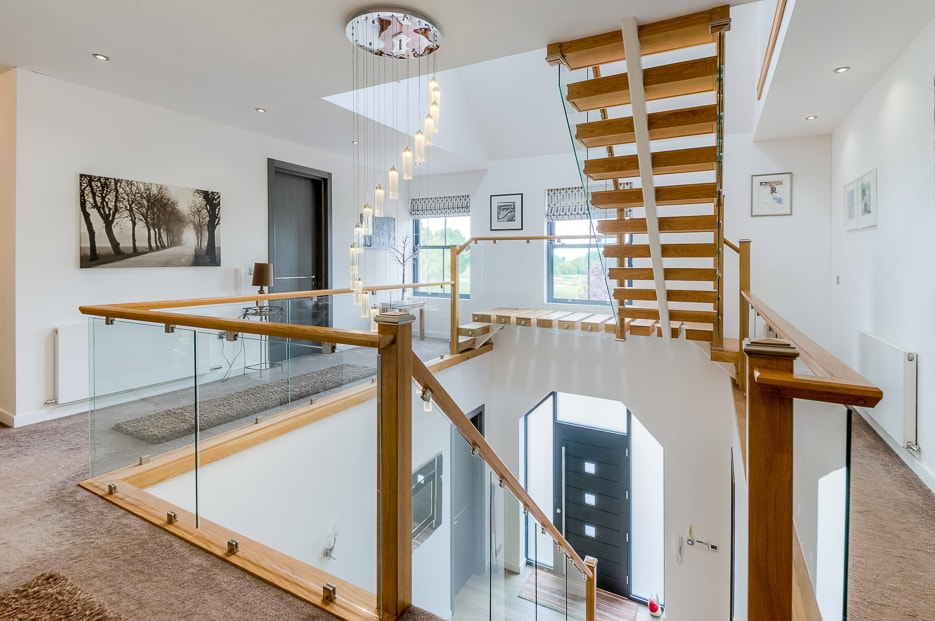 Photograph of a beautiful galleried landing with a view of the entrance atrium